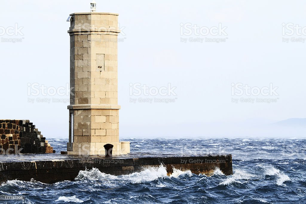 Picture represents the lighthouse while blowing strong wind royalty-free stock photo