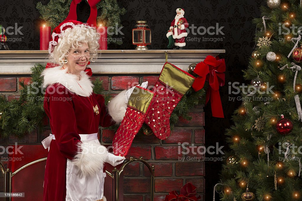 pictures of Real Ms. Claus getting the house ready stock photo