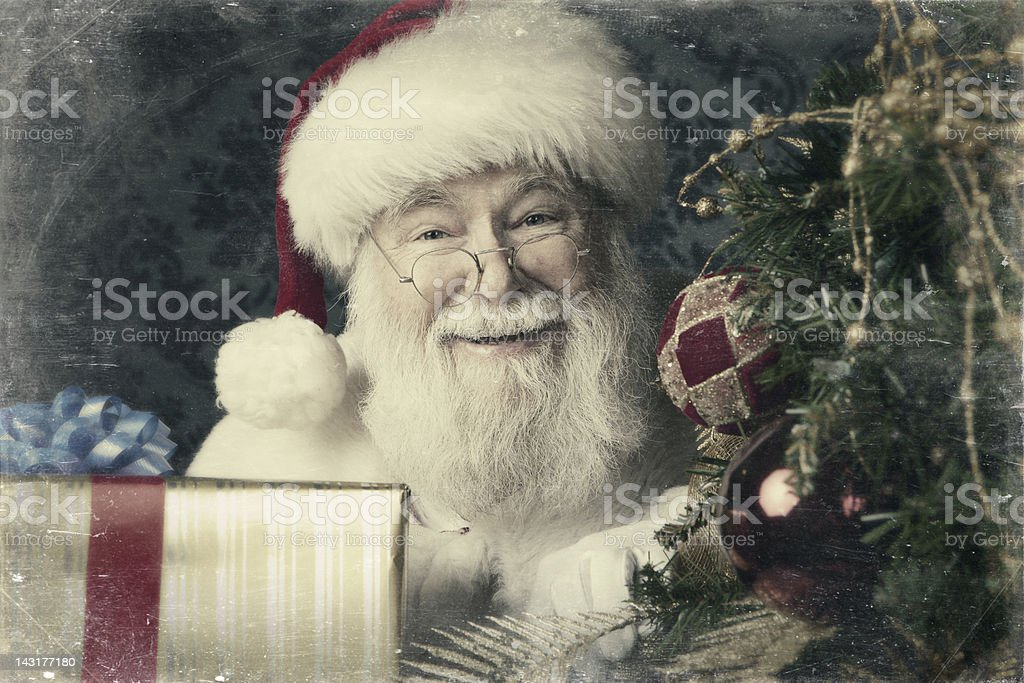Pictures of Real Santa Claus bringing presents stock photo