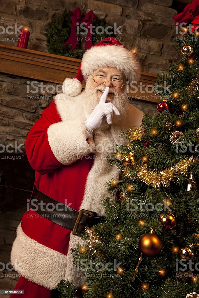 Pictures of Real Santa Claus Finger on Lips royalty-free stock photo