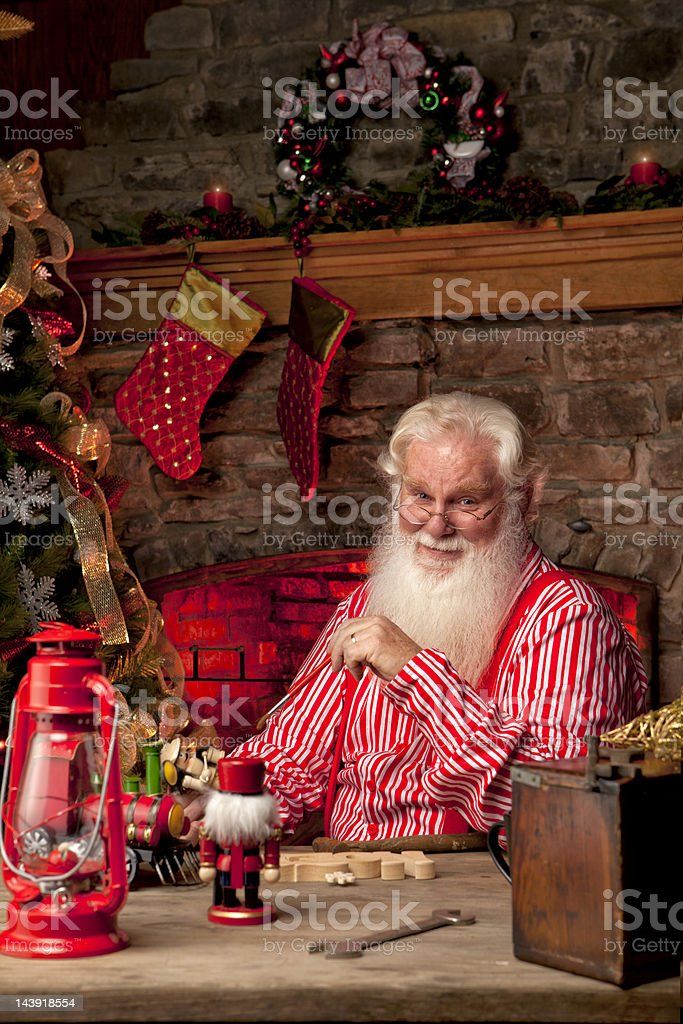 Pictures of Real Santa Claus in his workshop making toys royalty-free stock photo