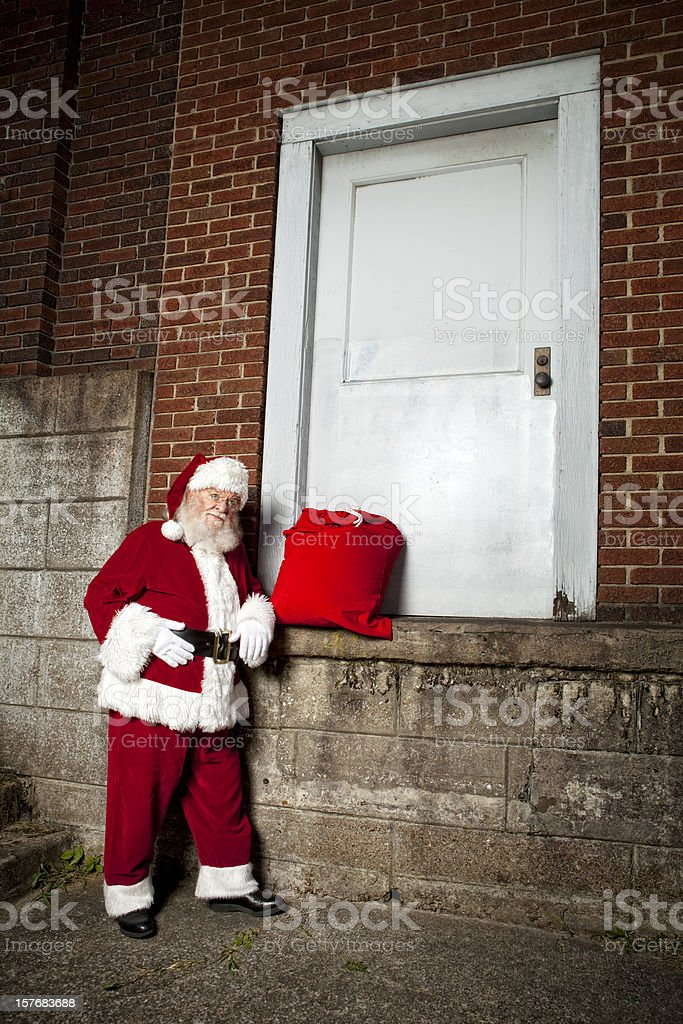 Pictures of Real Santa Claus leaning ona wall royalty-free stock photo
