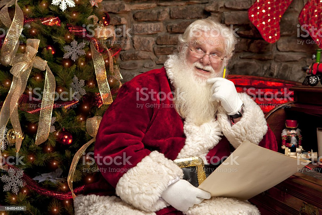 Pictures of Real Santa Claus making his naughty nice list royalty-free stock photo