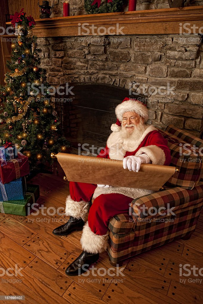 Pictures of Real Santa Claus reading naughty nice list royalty-free stock photo