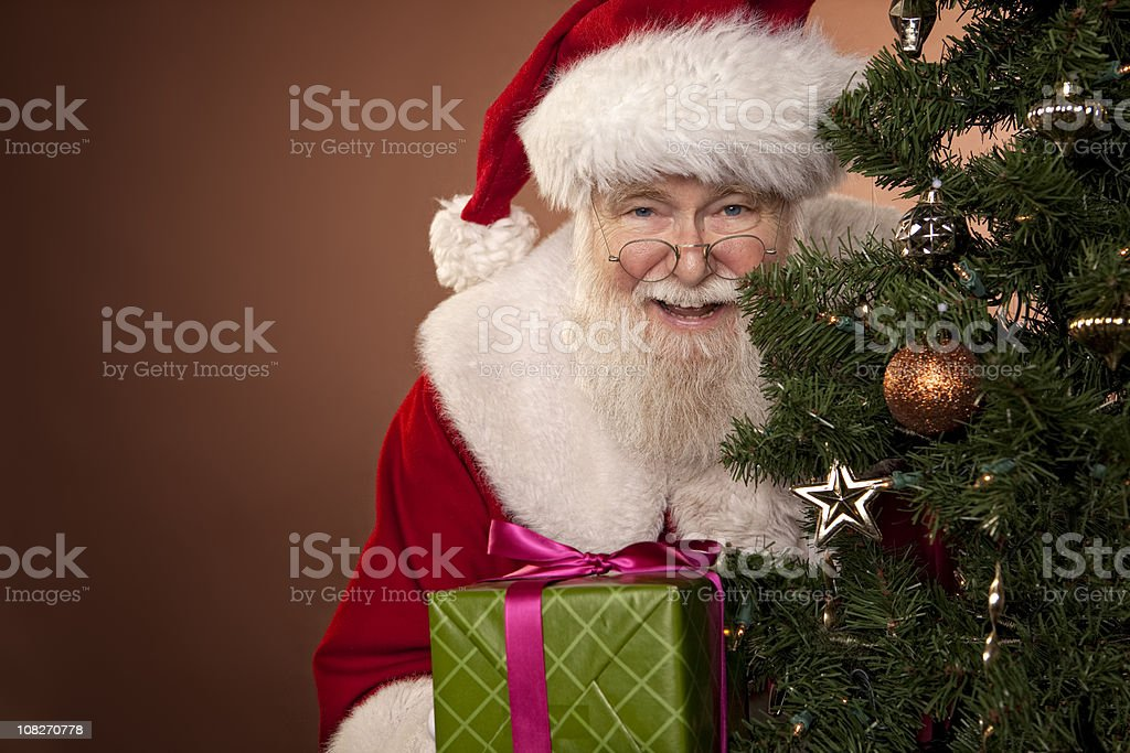 Pictures of Real Santa Has A Gift royalty-free stock photo