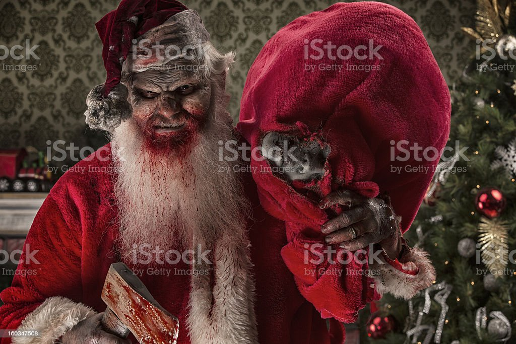 Serial Killer Santa Claws with a bag of victims stock photo