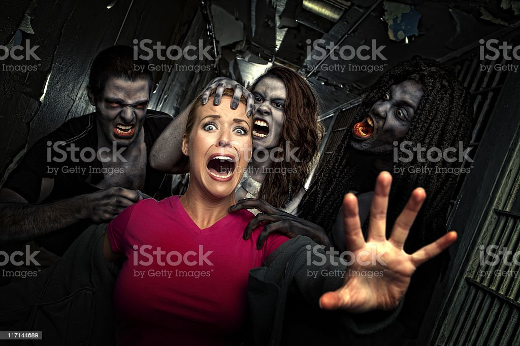 Pictures of Real Victim Struggles to get away from Zombies stock photo