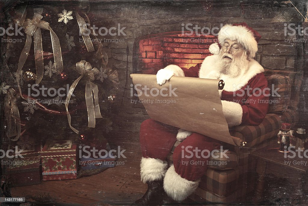 Pictures of Real Vintage Santa Claus checking his list twice stock photo