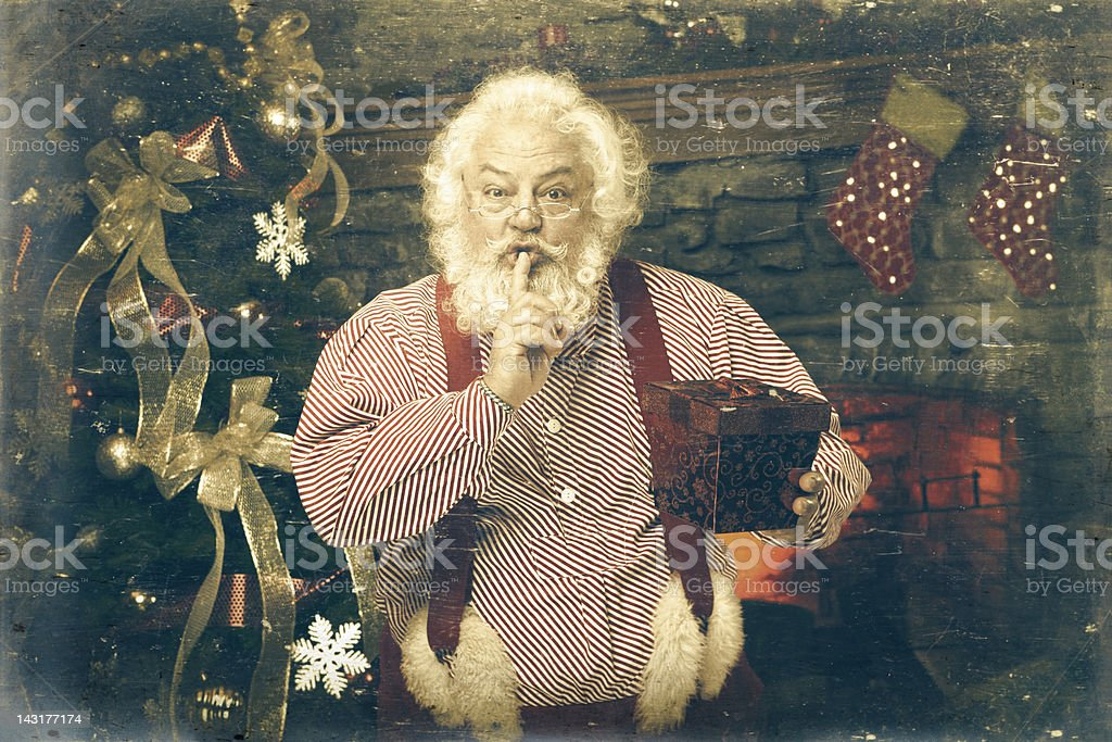 Pictures of Real Vintage Santa Claus holding gift royalty-free stock photo