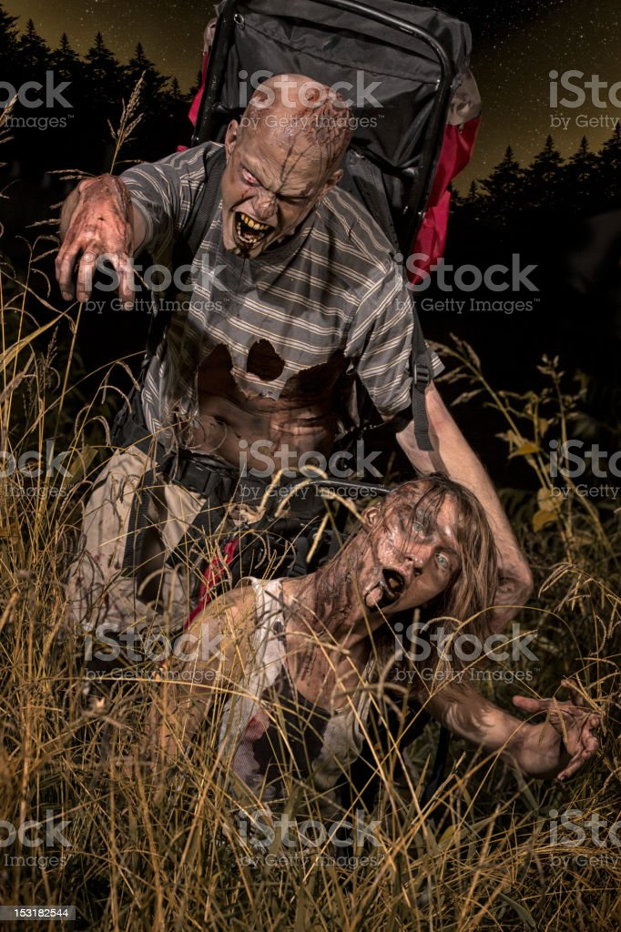 Pictures of Real Zombie Backpackers in woods on the attack stock photo