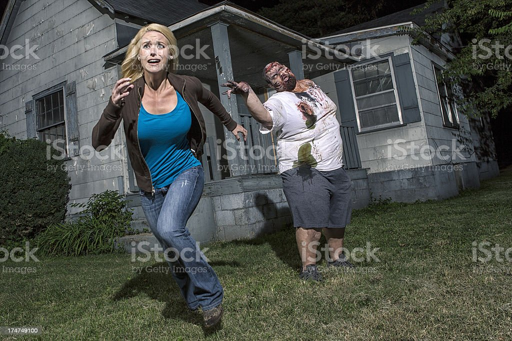 Pictures of Real Zombie Grabbing for Screaming Victim stock photo