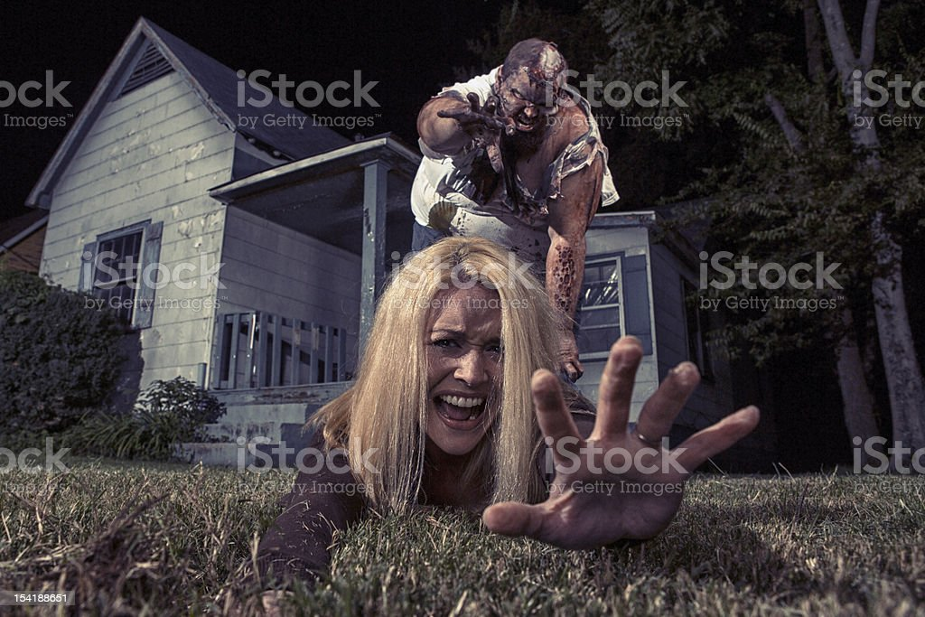 Pictures of Real Zombie Victim grabbing for help stock photo