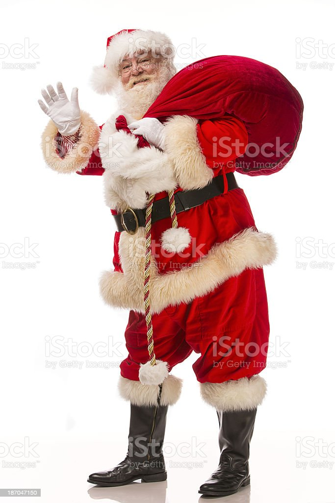 Pictures of Vintage Real Santa Claus carrying a gift sack royalty-free stock photo