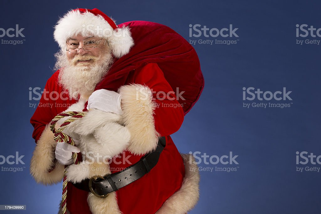 Pictures of Vintage Real Santa Claus carrying gift bag royalty-free stock photo