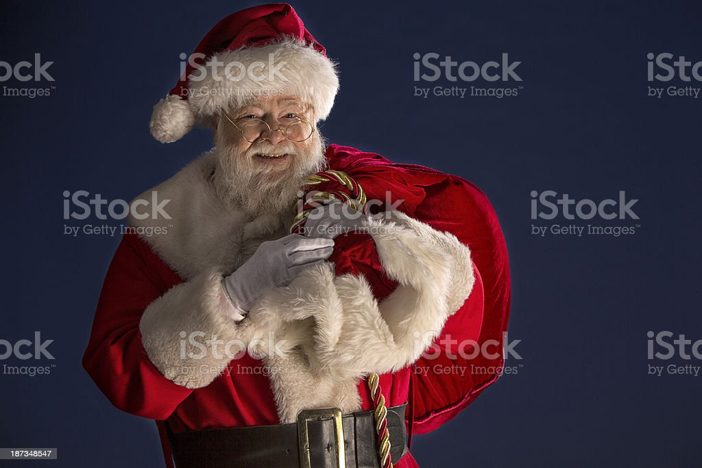 Pictures of Vintage Real Santa Claus carrying gift sack. royalty-free stock photo