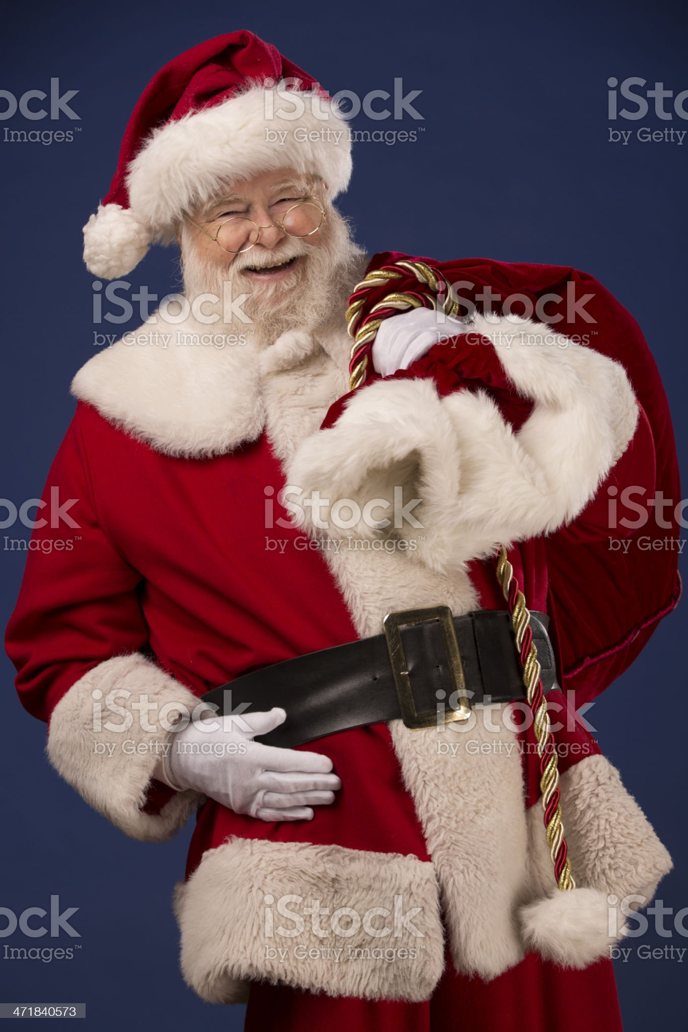Pictures of Vintage Real Santa Claus carrying gift sack royalty-free stock photo