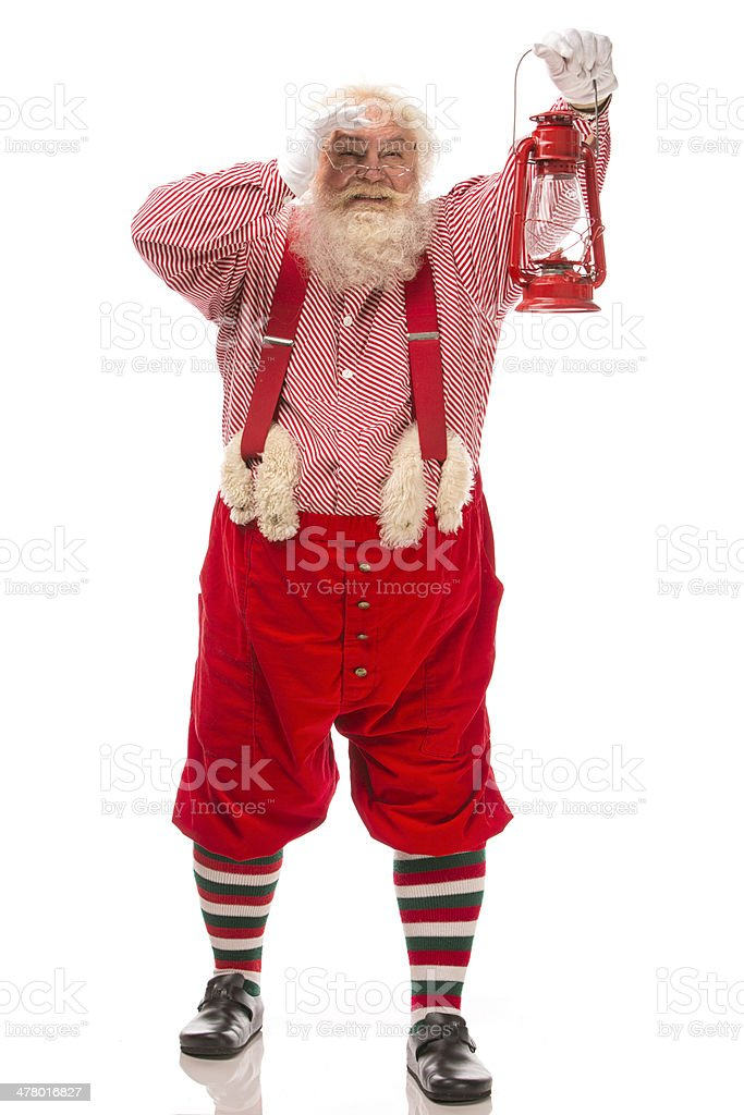 Pictures of Vintage Real Santa Claus carrying lantern royalty-free stock photo