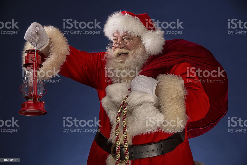 Pictures of Vintage Real Santa Claus holding a lantern royalty-free stock photo