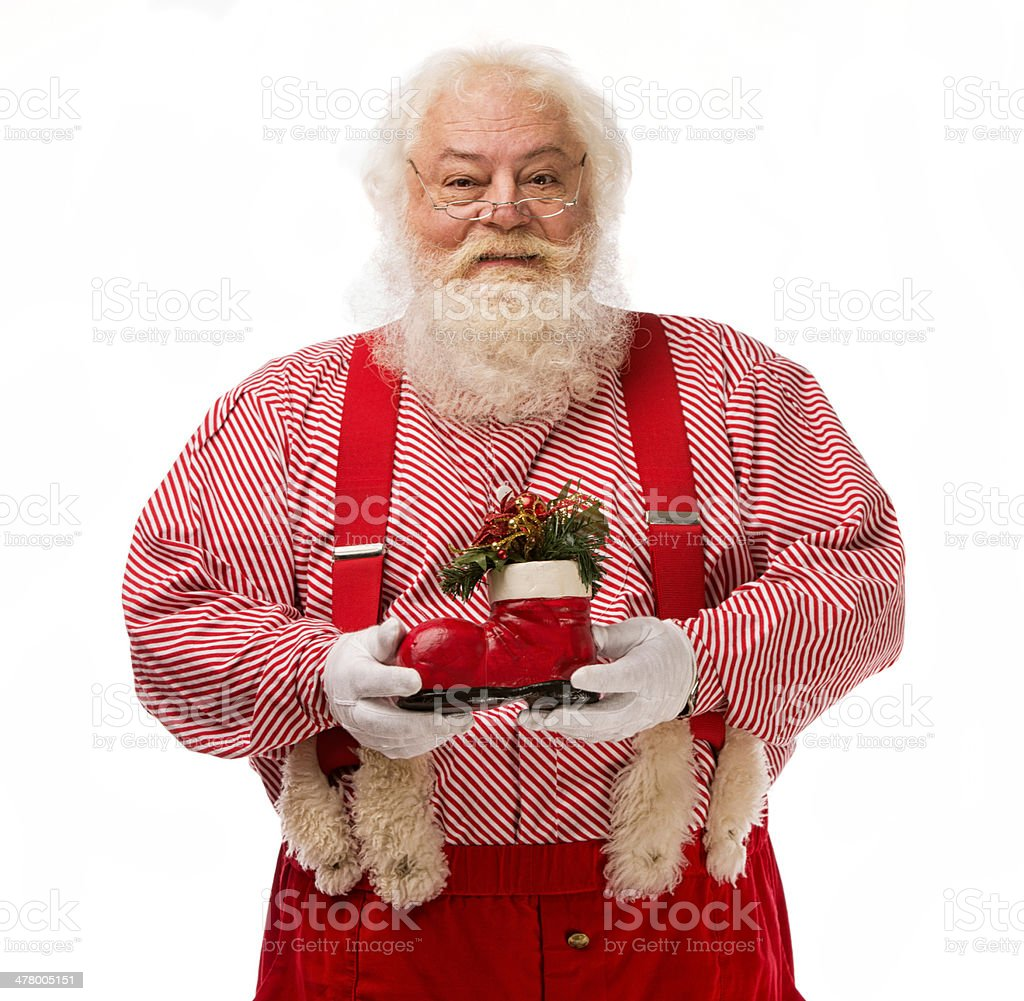 Pictures of Vintage Real Santa Claus holding a red boot royalty-free stock photo