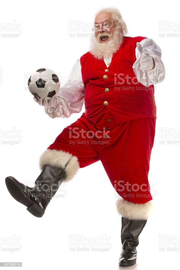 Pictures of Vintage Real Santa Claus kicking a soccer ball. royalty-free stock photo