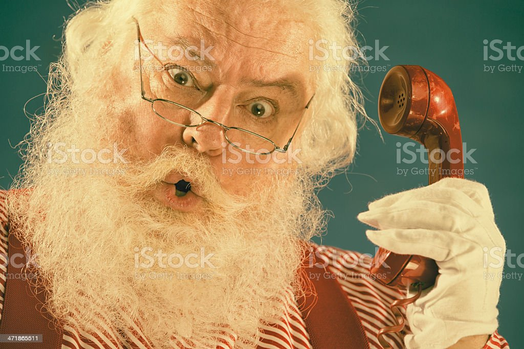 Pictures of Vintage Real Santa Claus on the telephone royalty-free stock photo