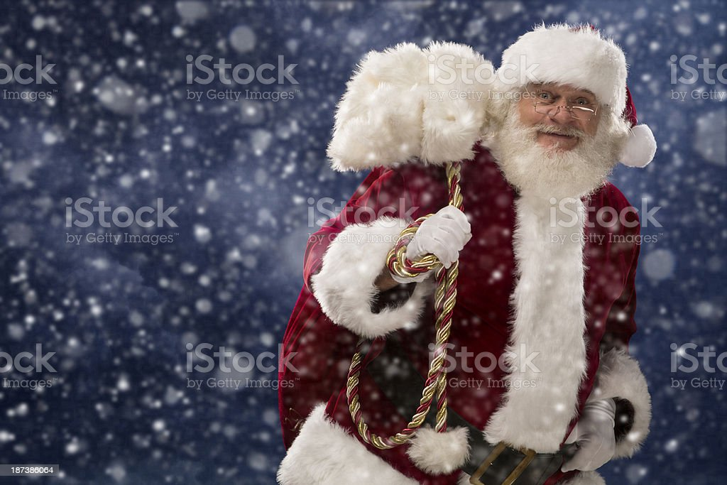 Pictures of Vintage Real Santa Claus walking in snow storm royalty-free stock photo