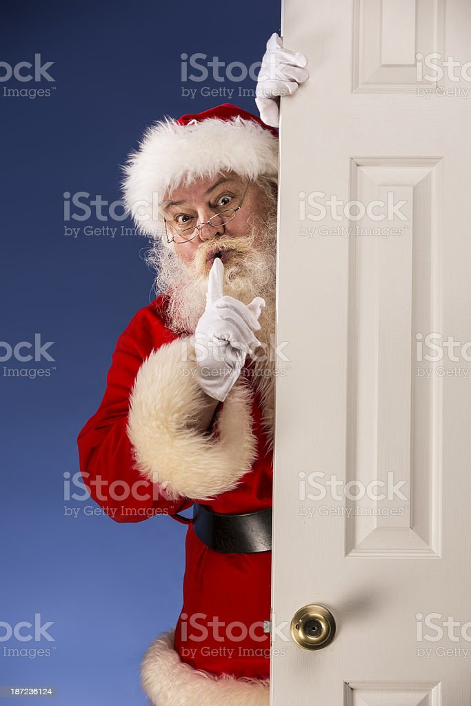Pictures of Vintage Real Santa Claus with finger on lips royalty-free stock photo
