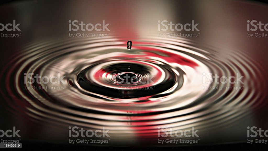 Pictures water drops beautiful shape on Red and white Backgrou royalty-free stock photo