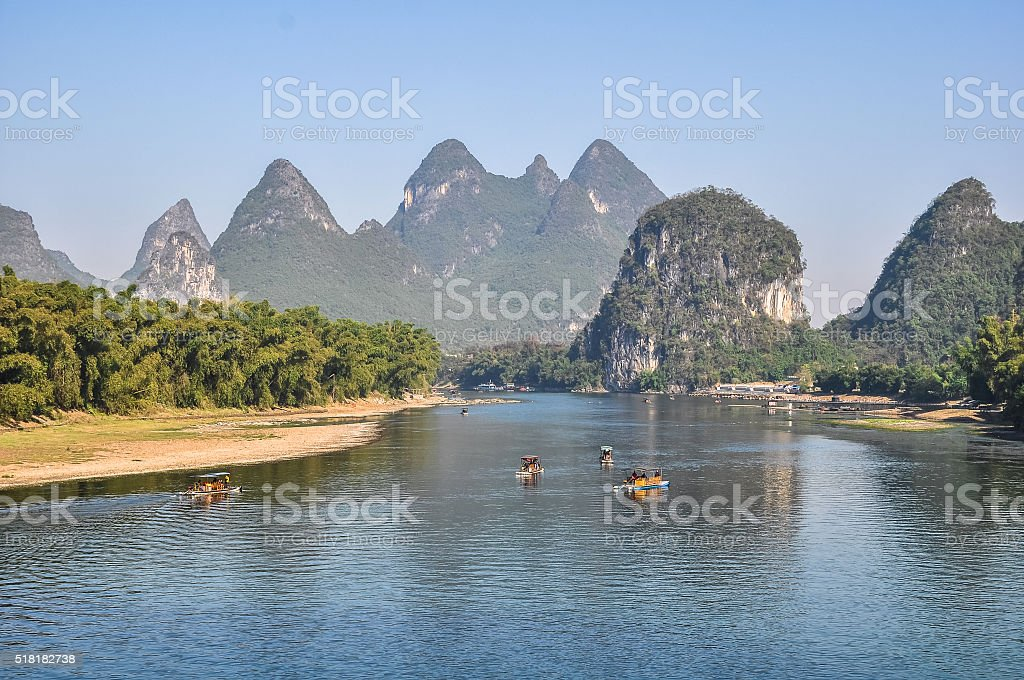 Picturesque banks of the river on a mountains background stock photo