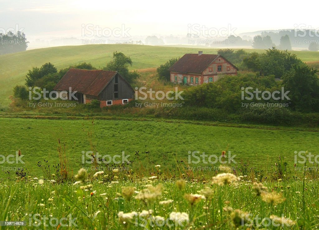 Picturesque farm in lush green countryside stock photo