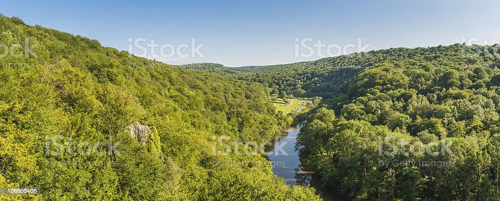 Picturesque green forest river valley campsite panorama royalty-free stock photo