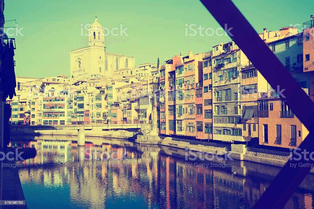 picturesque houses and church   from Eiffel bridge  in Gerona. stock photo