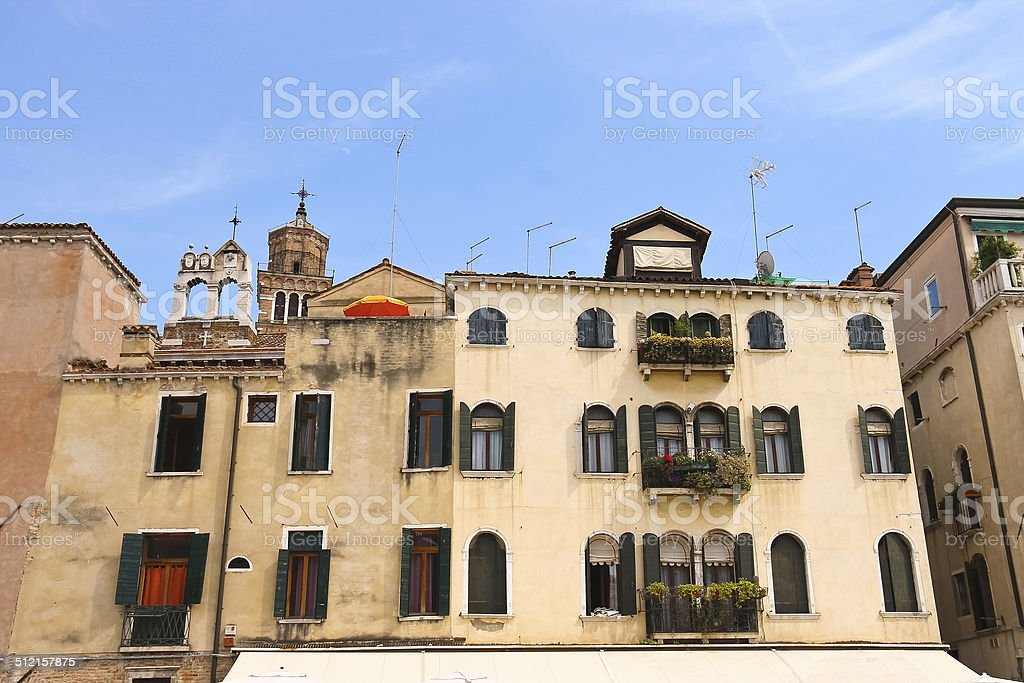 Picturesque Italian house on a background of Church Santa Maria stock photo