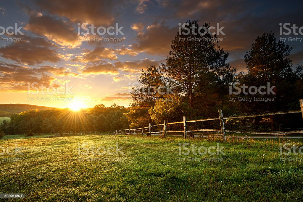 Picturesque landscape, fenced ranch at sunrise stock photo