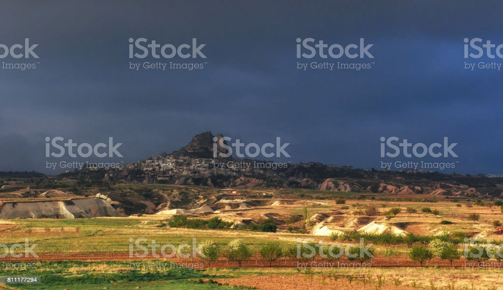 A picturesque landscape with a volcanic canyon in storm weather.
