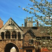 Picturesque old buildings near Gloucester Cathedral in spring sunshine, Gloucestershire