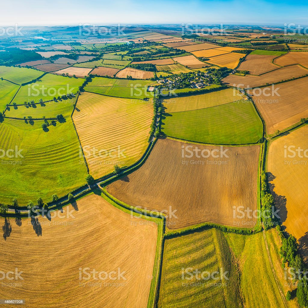 Picturesque patchwork quilt farmland aerial view over fields rural villages stock photo