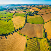 Picturesque patchwork quilt farmland aerial view over fields rural villages