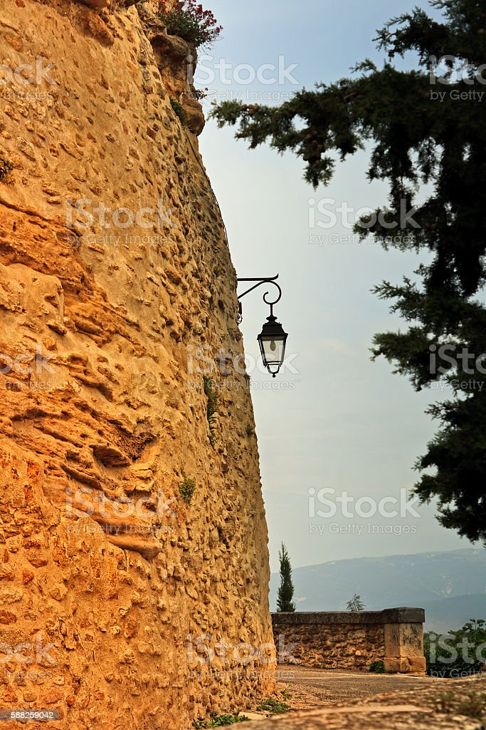 Picturesque Provence: City wall of Grignan in a dramatic light stock photo