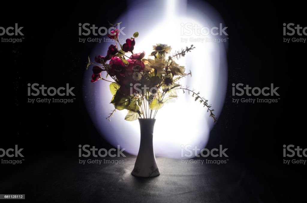 Picturesque purple spring flowers in glass vase standing in a row on...