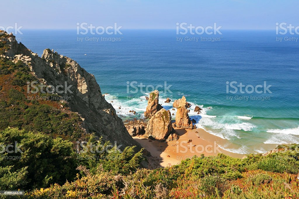 Picturesque rocks on a lonely beach of Atlantic ocean stock photo