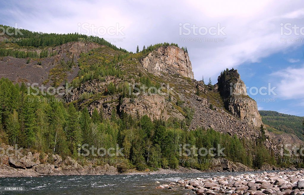 Picturesque rocks on the bank of the mountain river. stock photo