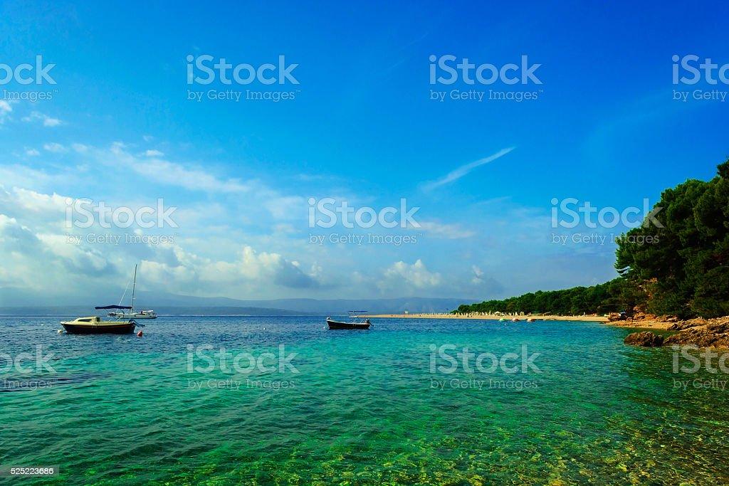 Picturesque scene of boats in Zlatni rat beach, Brac, Croatia stock photo