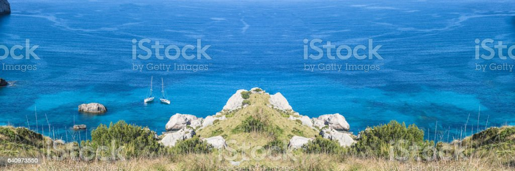 Picturesque sea landscape with bay and sailing ship stock photo