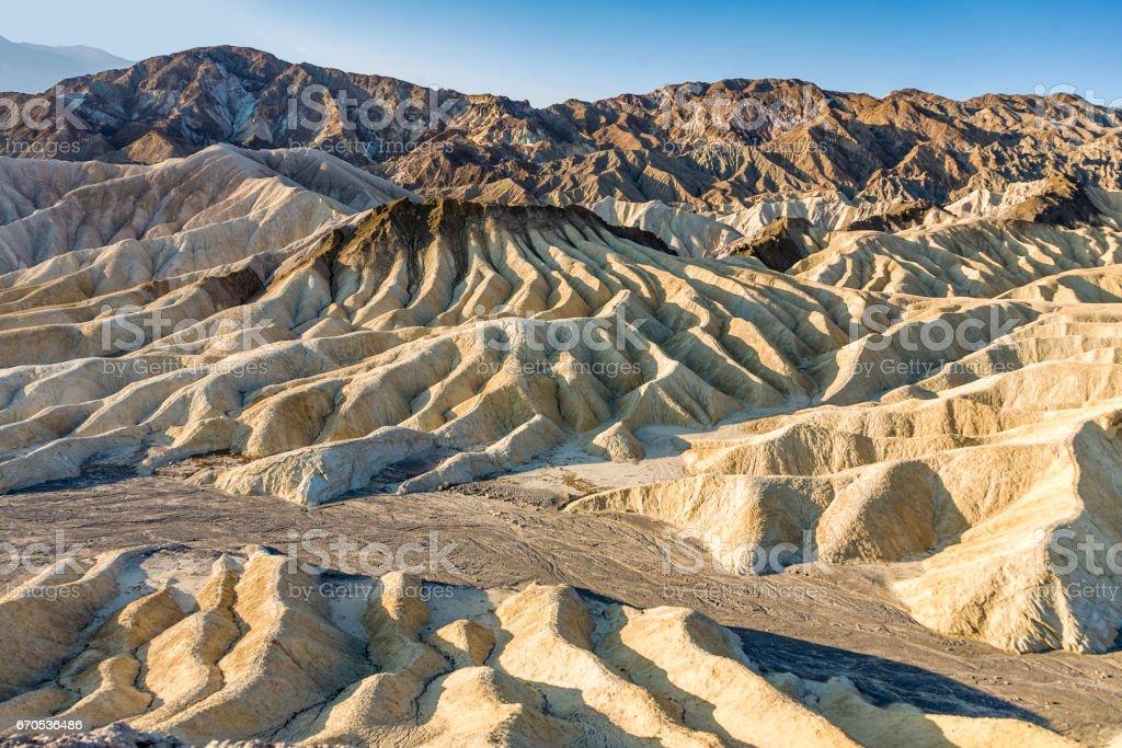 Picturesque soft waves from multi-coloured sandstone. Death valley, Zabriski stock photo