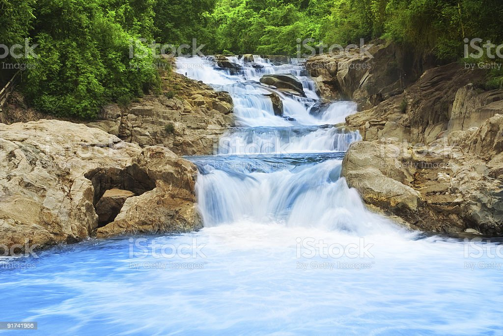 Picturesque view of a waterfall streaming down the middle royalty-free stock photo