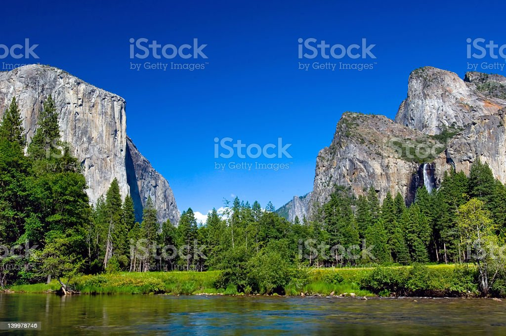 A picturesque view of El Capitan and Lower Falls stock photo