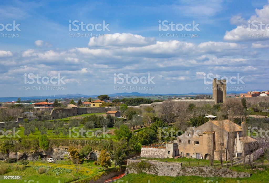 Picturesque view of outskirts of Viterbo, Italy with ancient building and wall stock photo