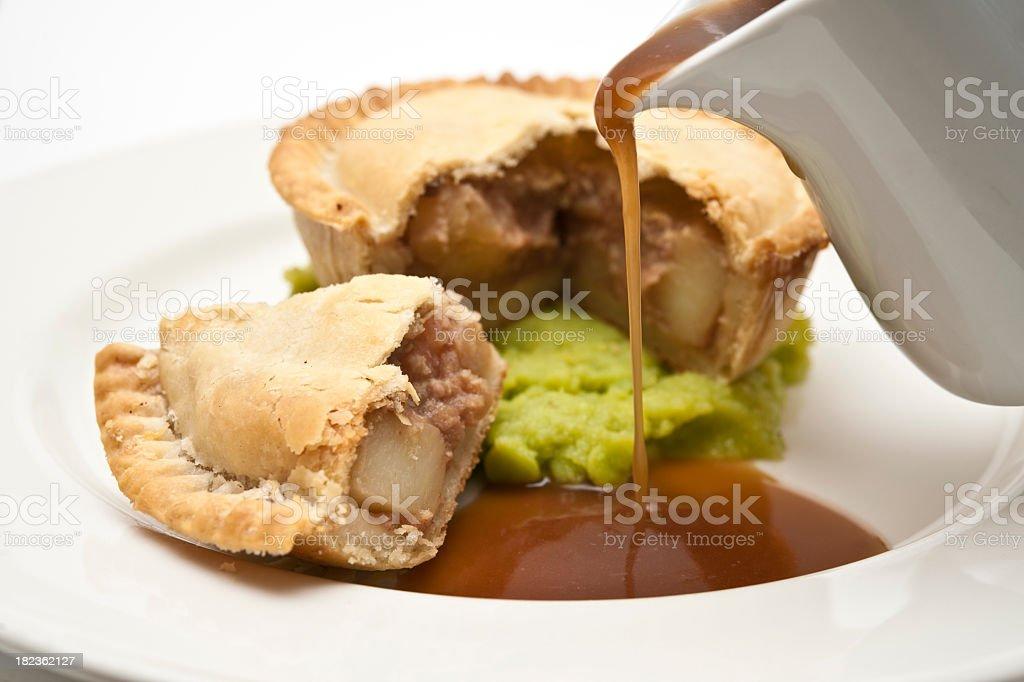 pie and mushy peas with gravy stock photo