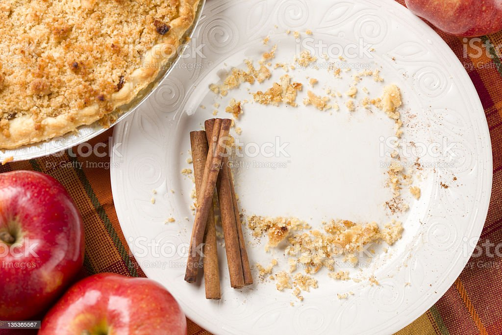 Pie, Apples, Cinnamon Sticks and Copy Spaced Crumbs on Plate stock photo